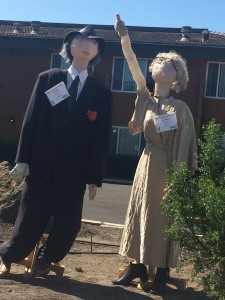 scarecrow couple pointing